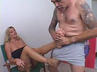 Sexy blonde babe gets pleasurable foot licking action from tatooed lover