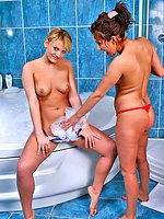 Two naughty girlies playing in the bath