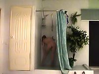Hidden cam in the shower films a nude babe