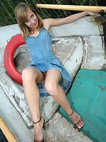 Short jeans dress of lusty babe can�t hide her nude cunt