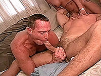Buffed-up bisexual gagging over huge cock in a steamy threesome