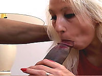 White slut tries to gobble up this huge black cock