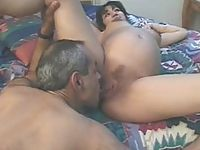 Dark-haired preggy babe gets pussy licking thrill from matured partner