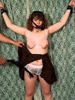Curly brunette gagged and tit clamped