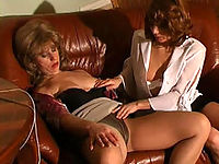 Sexed up milf seducing a leggy girl into wet tongue kissing and tit-to-clit