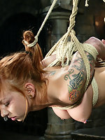 sexy redhead is tied up and water-tortured