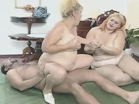 Busty mature in group sex on bed