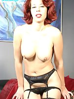 Busty slut in black nylons shows her trimmed slit