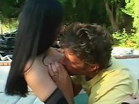 Angel-faced dark-haired latina in nipple sucking foreplay outdoors