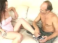 Older guy playes toes of brunette in high heels