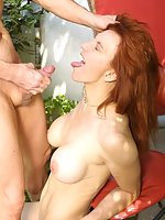 pretty redhead taking on bearded guy's cum