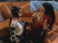 Latex lesbians using strapon dildo