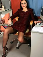 Gorgeous brunette secretary Afina in black stockings