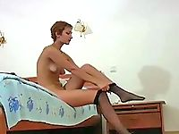 Watch a girl dressing on her pantyhose