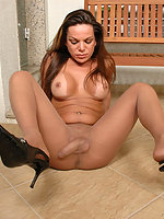 Lascivious shemale teasing with her feet clad in creamy smooth pantyhose