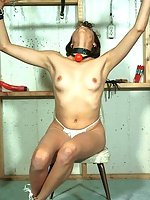 Thai gagged with clamps on tits