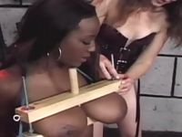 Ebony slave slut in heavy breast bondage