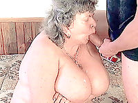 Mature bitch with huge tits swallowing fresh load of jizz