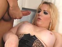 Blonde shemale gets cumshot on tits