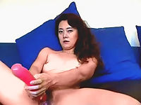 Sex starved asian slut pleasures her wet cunt with a double-ended dildoe.