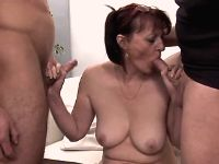 Lewd mature sucking dicks in orgy