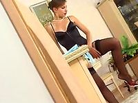 Babe getting spied on while trying on and enjoying the feel of new hosiery