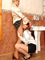 Blondie can�t look calmly at her co-worker dildoing her nyloned pink in WC