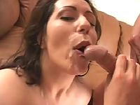 Dark-haired older woman enjoying the sum burst out inside her mouth