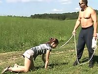 Gymnastic puss gets leashed and walked outdoors