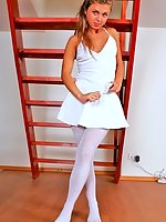 Flexible brunette Amy does legs stretching in white pantyhose