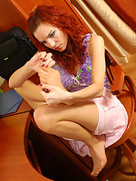 Curly secretary in open toes pantyhose tenderly touching her nyloned feet