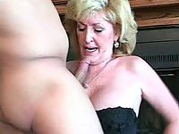 Horny blonde MILF kneels down and sucks cock
