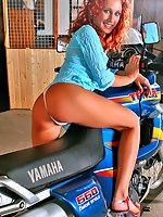 Redhead Liza in white panties loves bikes and show herself!