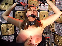 Redheaded bitch gets her mouth filled with a vib gag