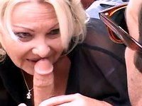 Elder mature gets blowjob outdoor