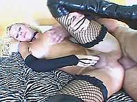 Shemale in high boots enjoys anal