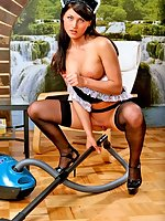 Brunette maid Lana posing with vacuum cleaner in black stockings and maid outfit