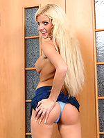 Leggy blonde starlet tries sexy blue panties on