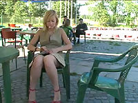 Nasty teen biatch plays with her clam in a cafe