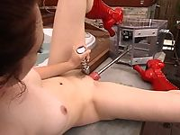 Justine Joli gets a pussy pounding by machines.