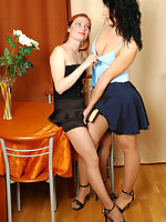 Heated lesbian cuties in barely visible tights having fun with a strap-on