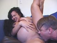 Massively titted dark-haired preggy whore indulging in tongue licking foreplay