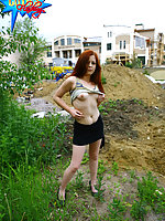 Loose redhead gets naked at a construction site