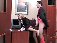 Sexy secretary throwing off her high heel shoes to play nylon footsy game