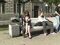 Teen flasher opens coat while sitting on a bench