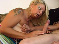 Tattooed blonde oldie gagging on a fat young dong