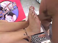 Brunette bitch playfully hardens hairy dick with her cute feet.