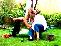 Two guys and a bitch delights in a steamy kissing and sucking bisexual act by the garden.