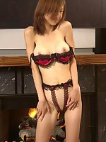 Hot Oriental babe gets rid of bra and garter belts