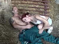 Redhead young gal licking two cocks
